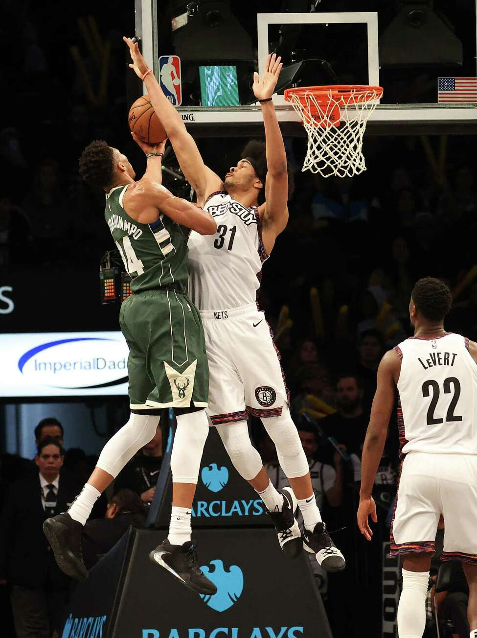 NEW YORK, NEW YORK - JANUARY 18: Giannis Antetokounmpo #34 of the Milwaukee Bucks shoots against Jarrett Allen #31 of the Brooklyn Nets during their game at Barclays Center on January 18, 2020 in New York City. NOTE TO USER: User expressly acknowledges and agrees that, by downloading and/or using this photograph, user is consenting to the terms and conditions of the Getty Images License Agreement. (Photo by Al Bello/Getty Images)