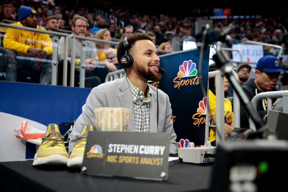 Golden State Warriors guard Stephen Curry analyzes the game for NBC in the second half of an NBA game at Chase Center, Saturday, Jan. 18, 2020, in San Francisco, Calif. The Warriors won 109-95 against the Orlando Magic.