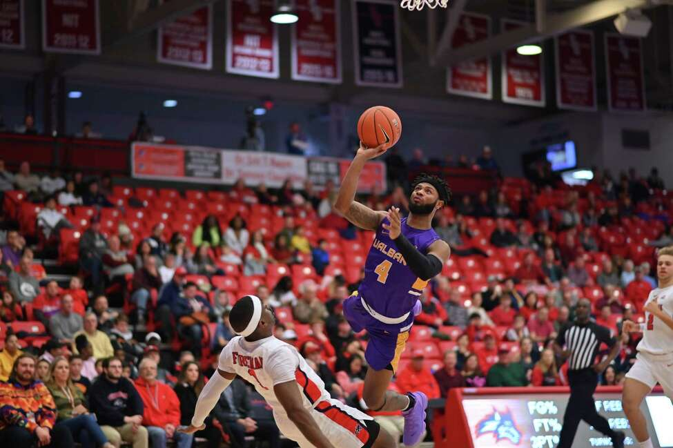 UAlbany's Ahmad Clark puts up a shot over a Stony Brook defender during their game on Saturday, Jan. 18, 2020. (Jim Harrison / Image Habitat, Inc.)
