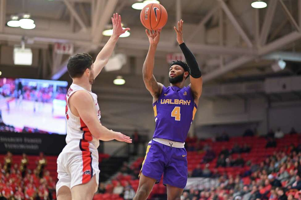 UAlbany's Ahmad Clark puts up a jump shot over a Stony Brook defender during their game on Saturday, Jan. 18, 2020. (Jim Harrison / Image Habitat, Inc.)