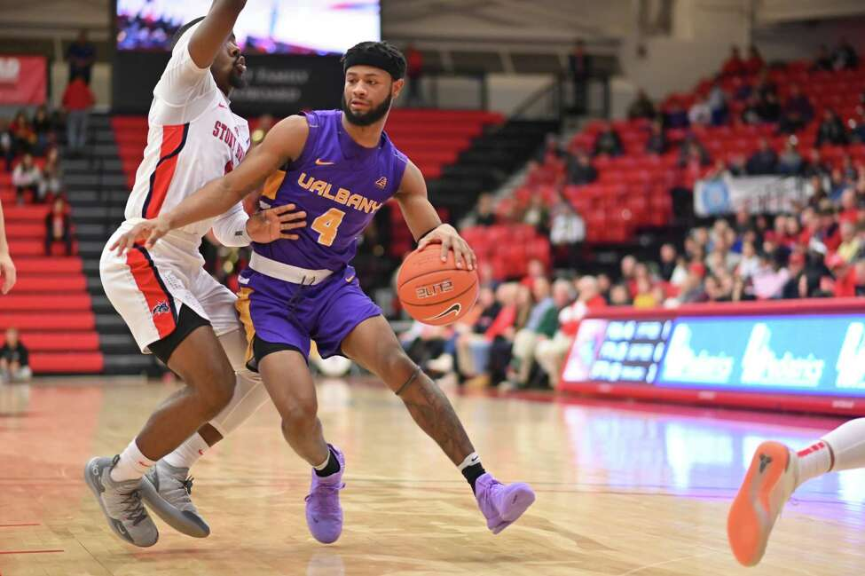 UAlbany's Ahmad Clark tries to get around a Stony Brook defender during their game on Saturday, Jan. 18, 2020. (Jim Harrison / Image Habitat, Inc.)