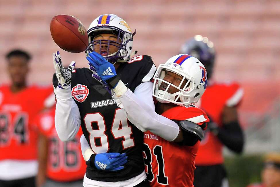 American Team wide receiver Juwan Green, left, of Albany, attempts a catch only to have it broken up by National Team cornerback L'Jarius Sneed, of Louisiana Tech, during the first half of the Collegiate Bowl college football game Saturday, Jan. 18, 2020, in Pasadena, Calif. (AP Photo/Mark J. Terrill)