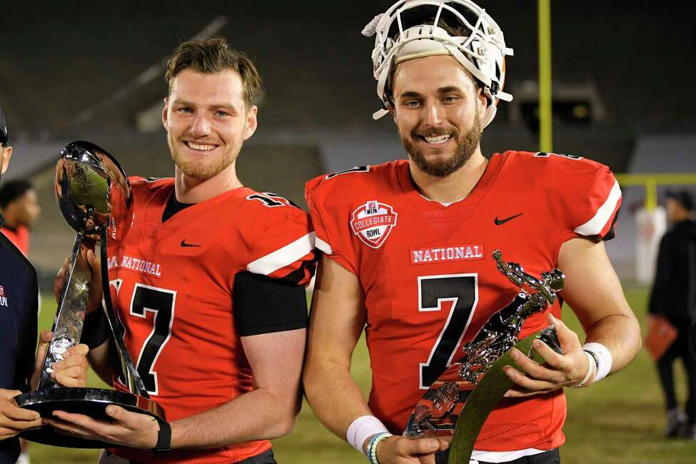 National Team quarterback Reid Sinnett, left, of San Diego, holds the game trophy while National Team quarterback Nick Tiano, of Chattanooga, holds the MVP trophy following the team's Collegiate Bowl college football game against the American Team on Saturday, Jan. 18, 2020, in Pasadena, Calif. The National Team won 30-20. (AP Photo/Mark J. Terrill)