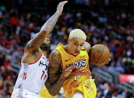 Los Angeles Lakers forward Kyle Kuzma (0) tries to get past Houston Rockets forward PJ Tucker (17) during the second half of an NBA game at the Toyota Center on Saturday, Jan. 18, 2020. The Lakers won 125-115.