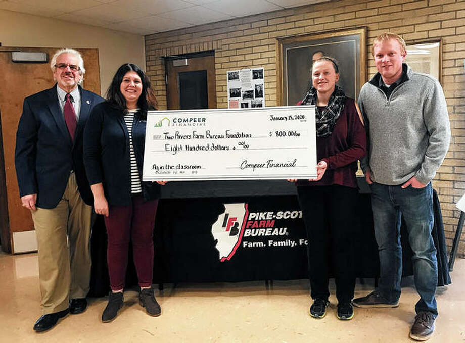 Compeer Financial Financial Officer Jessica Carolan (second from left) and Compeer Financial Crop Insurance Officer Brock Willard (right) present to Pike-Scott Farm Bureau Executive Director Blake Roderick (left) and Pike-Scott agriculture literacy coordinator Rachel Poor a check representing an $800 donation to benefit the bureau's Agriculture in the Classroom program. Photo: Photo Provided