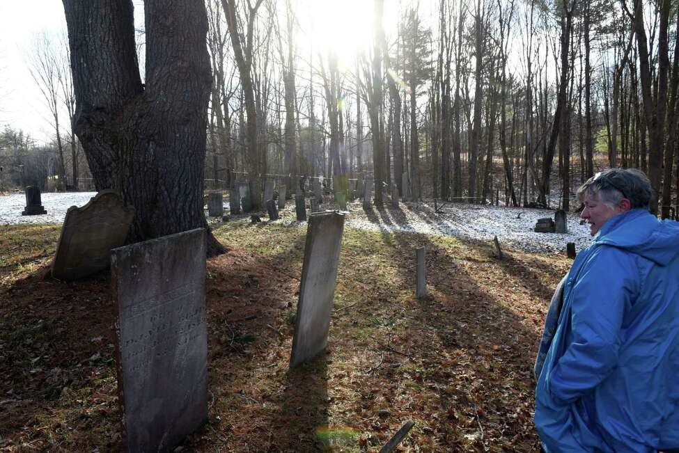 Debi Craig, immediate past president of the Washington County Historical Society and member of the Greenwich Easton Historical Association, shows where Susan B. Anthony's grandparents are buried in Battenville Cemetery on Friday, Jan. 17, 2020, in Battenville, N.Y. (Will Waldron/Times Union)