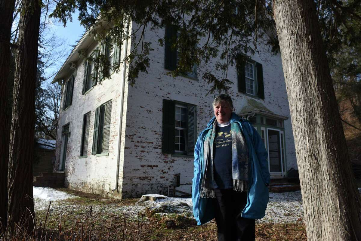 Debi Craig, immediate past president of the Washington County Historical Society and member of the Greenwich Easton Historical Association, stands outside Susan B. Anthony's early childhood home on Friday, Jan. 17, 2020, on State Route 29 in Battenville, N.Y. Several local history groups have been trying to entice the state to renovate this historic home, but so far to no avail. (Will Waldron/Times Union)