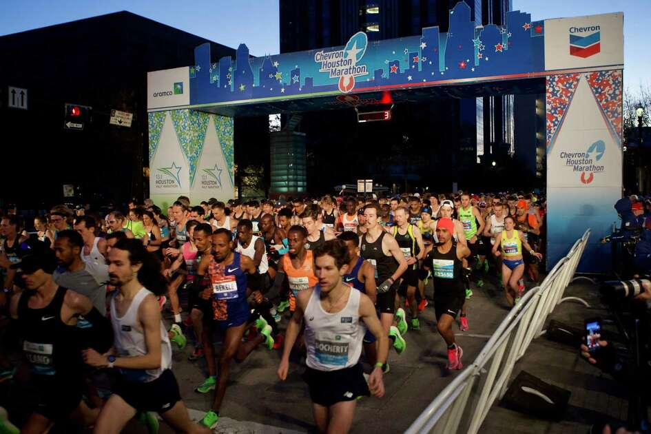 Runners take off from the starting line of the 48th running of the Chevron Houston Marathon Sunday, Jan. 19, 2020, in Houston.