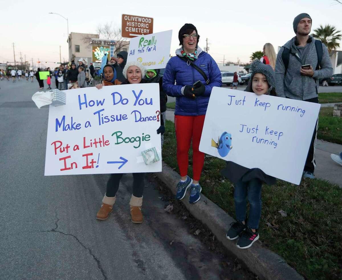 People cheer on runners on Washington Avenue during the Chevron Houston Marathon, in Houston, Sunday, Jan. 19, 2020.
