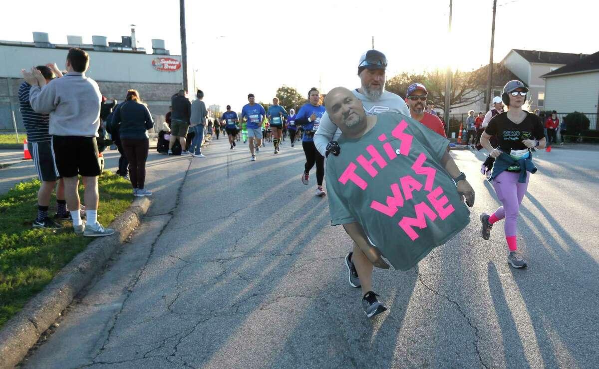 Runners on Washington Avenue during the Chevron Houston Marathon, in Houston, Sunday, Jan. 19, 2020.