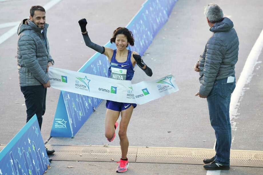 Hitomi Niiya breaks the tape to win the women's Aramco Half Marathon Sunday, Jan. 19, 2020, in Houston. Photo: Brett Coomer, Staff Photographer / © 2020 Houston Chronicle
