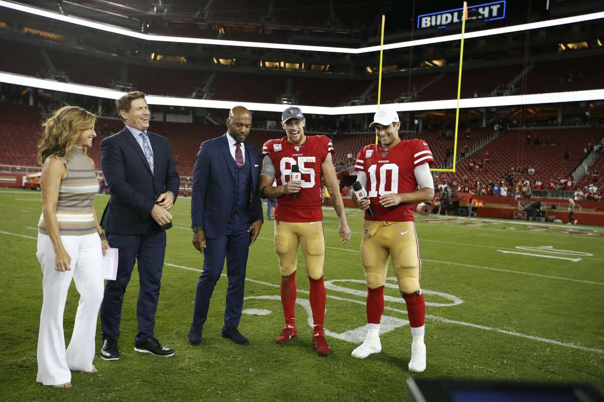 Suzy Kolber and Steve Young interview George Kittle and Jimmy Garoppolo of the San Francisco 49ers on the field following the game against the Cleveland Browns at Levi's Stadium on October 7, 2019. The 49ers defeated the Rams 31-3.