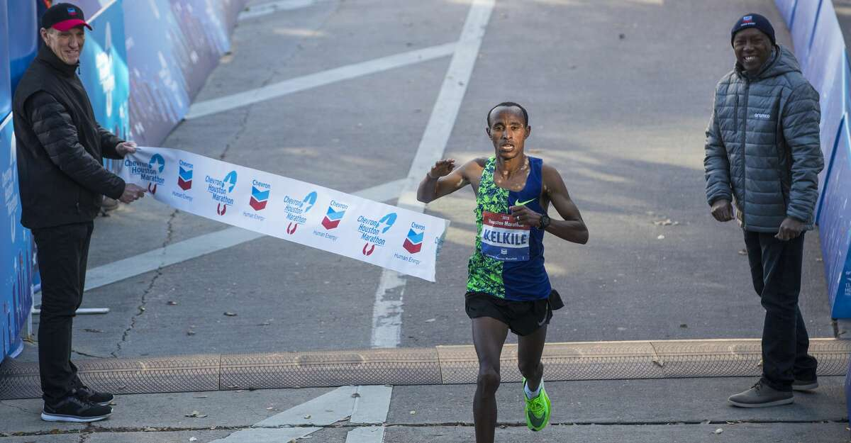 Kelkile Woldaregay Gezahegn breaks the tape to win the 48th running of the Chevron Houston Marathon Sunday, Jan. 19, 2020 in Houston.