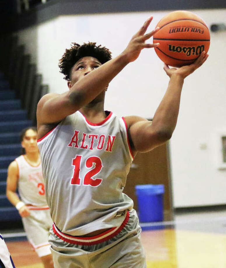 Alton's Lonnie Tate puts up a shot in a Dec. 7 game at the Marion Shootout. The Redbirds were back in another shootout Saturday and lost to Cardinal Ritter in the Martin Luther King Jr. Classic at East St. Louis. Photo: Greg Shashack / The Telegraph