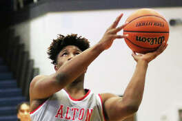 Alton's Lonnie Tate puts up a shot in a Dec. 7 game at the Marion Shootout. The Redbirds were back in another shootout Saturday and lost to Cardinal Ritter in the Martin Luther King Jr. Classic at East St. Louis.