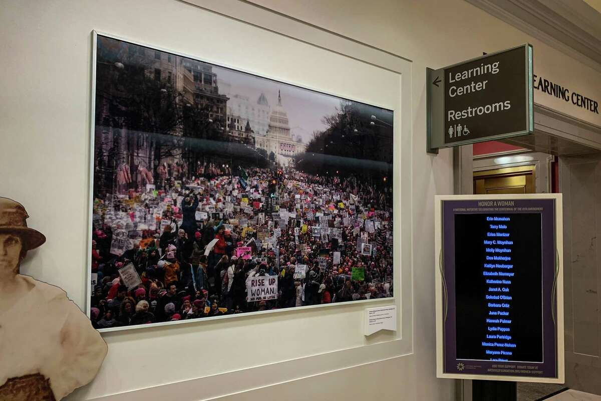 The altered photo of the Women's March on display at the National Archives.