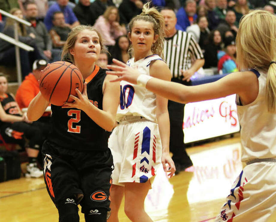 Gillespie's Hannah Barrett (2) puts up a shot between Carlinville defenders Corin Stewart and Jill Stayton (right) during a Carlinville Tournament game on Dec. 30 in Carlinville. On Saturday in Gillespie, the Miners picked up SCC victory over Roxana. Photo: Greg Shashack / The Telegraph