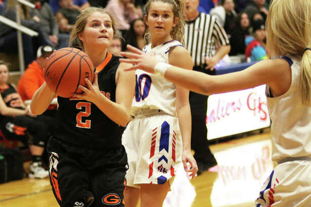 Gillespie's Hannah Barrett (2) puts up a shot between Carlinville defenders Corin Stewart and Jill Stayton (right) during a Carlinville Tournament game on Dec. 30 in Carlinville. On Saturday in Gillespie, the Miners picked up SCC victory over Roxana.