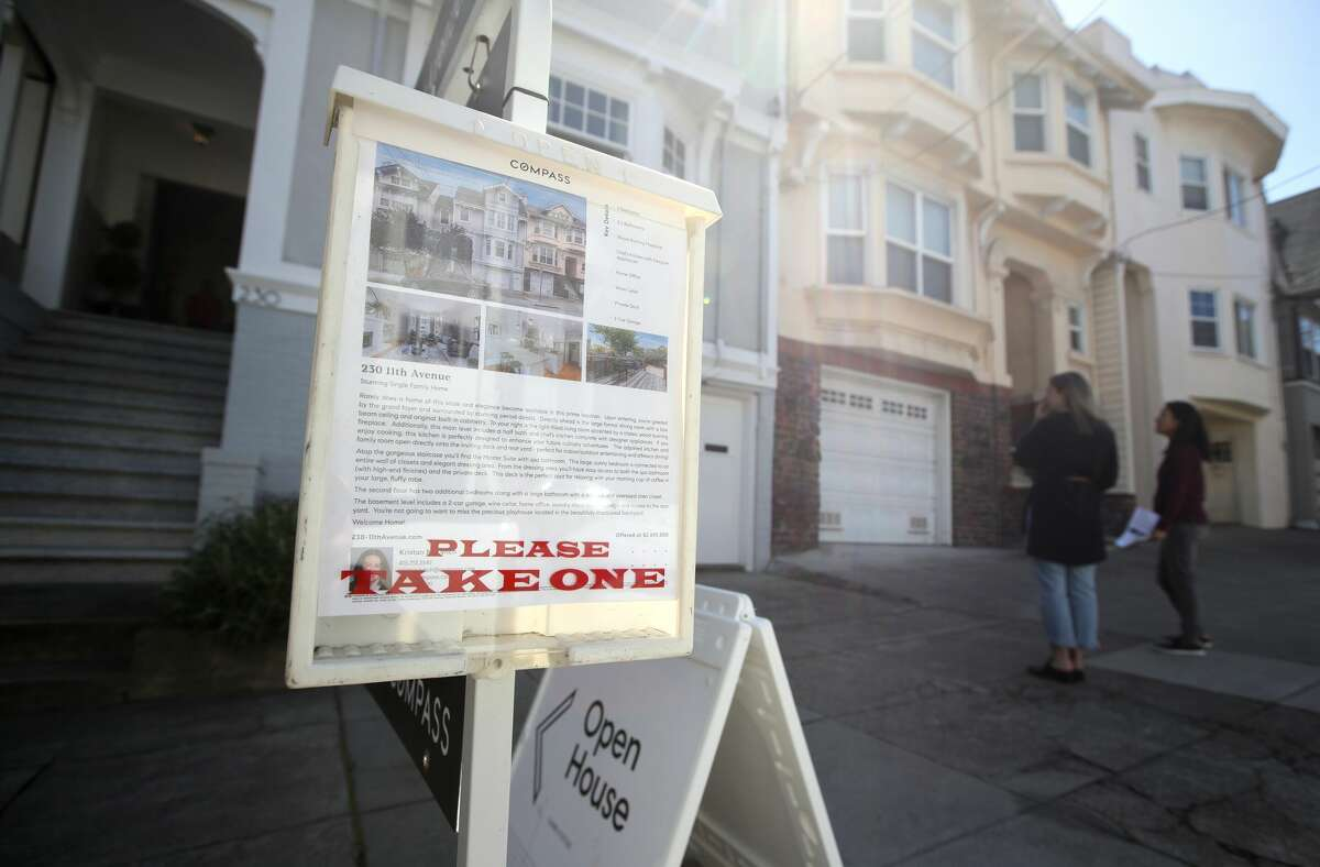 People look at a home for sale during an open house on April 16, 2019 in San Francisco. This spring, no open houses can take place and realtors have had to adjust quickly.