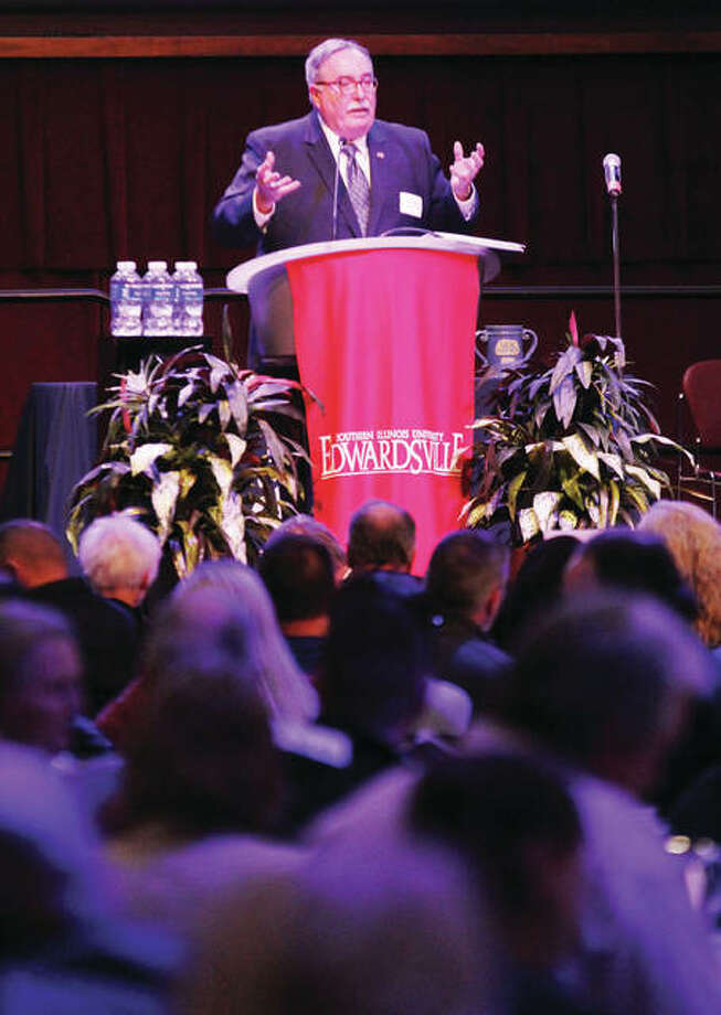 "John Hopkins, chairman of the Great Rivers and Routes Tourism Bureau board, speaks during the bureau's annual ""Tourism Summit,"" held Thursday at SIUE. Tourism in the region accounts for almost $700 million in economic impact, and almost 5,100 jobs."