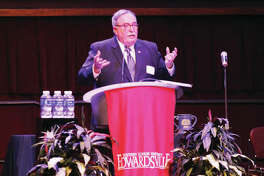 """John Hopkins, chairman of the Great Rivers and Routes Tourism Bureau board, speaks during the bureau's annual """"Tourism Summit,"""" held Thursday at SIUE. Tourism in the region accounts for almost $700 million in economic impact, and almost 5,100 jobs."""