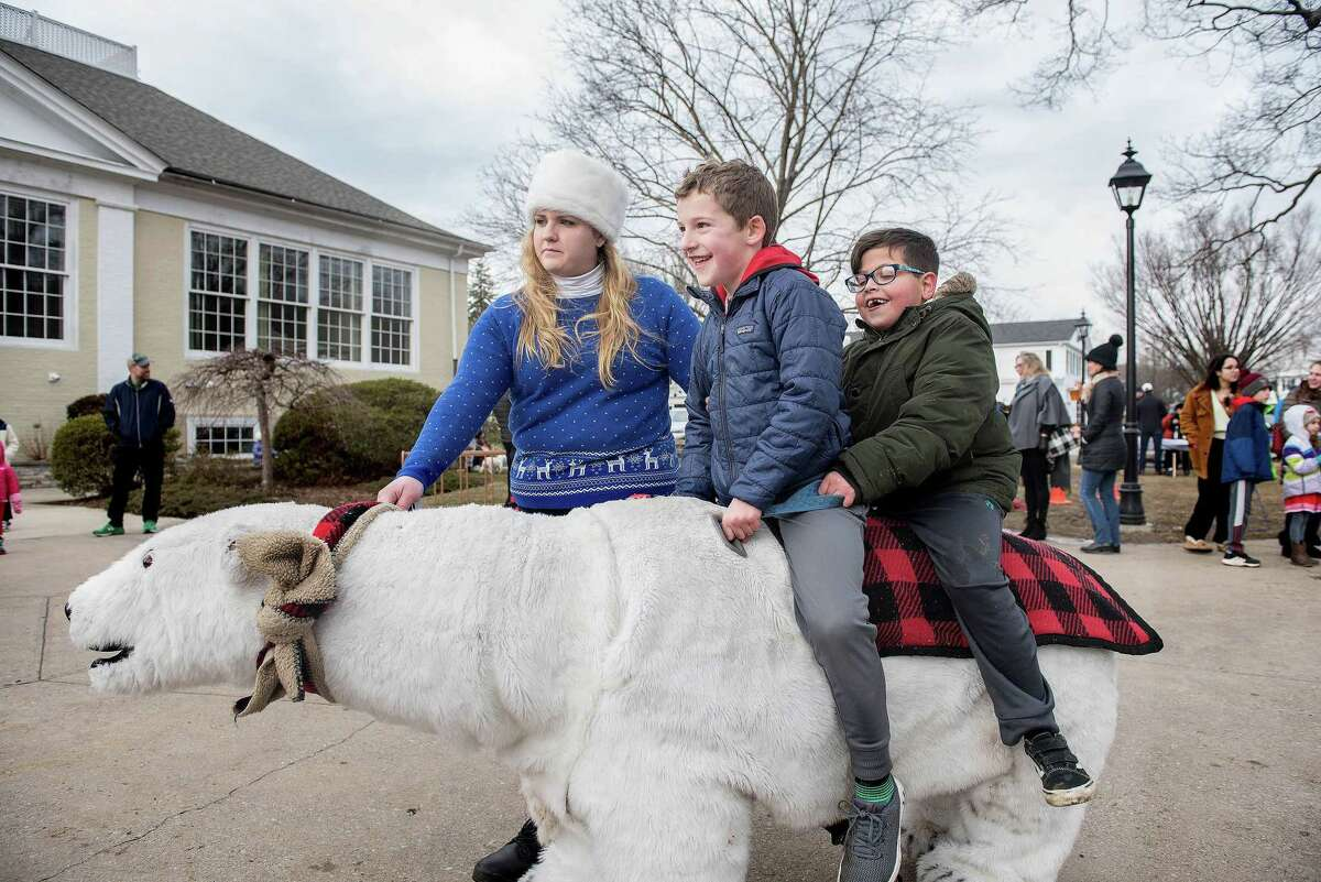 Nick Sposato and Ryan Ciannello ride a polar bear at last year's Winter Carnival. Safari Rides and Photos of Wallingford will be back again for this year's carnival on Sunday, Jan. 26, in Wilton Center.