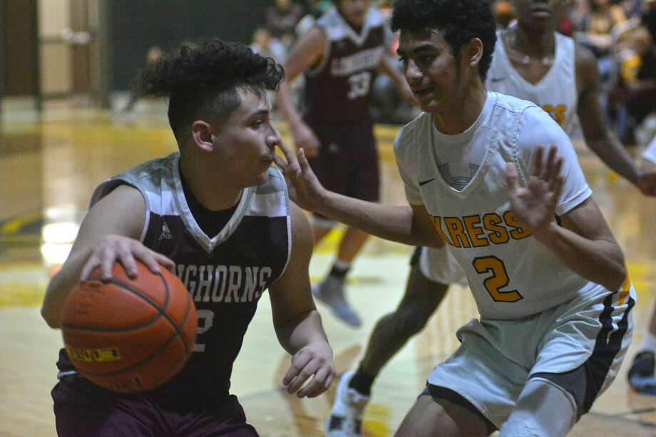 Hart's CJ Carrasco is guarded by Kress defender Julian Pinero during their District 4-1A boys basketball game on Friday at Kress High School. Photo: Nathan Giese/Planview Herald