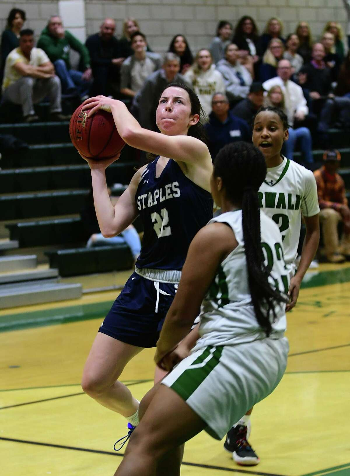Wrecker Kathleen Cozzi goes up for the shot as the Norwalk High Bears take on the Staples High School Wreckers in their FCIAC girls basketball game Tuesday, January 14, 2020, in Norwalk, Conn.