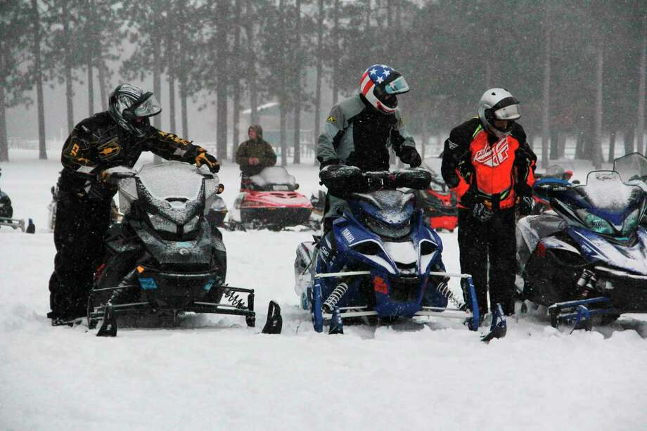 Area residents and snowmobilers gathered at Skinner Park in Irons to have their sleds blessed for a safe riding season. Before the blessing, guests had the opportunity to enjoy a hot breakfast before riding off on one of the many trails at the park. (Pioneer photos/Alicia Jaimes)