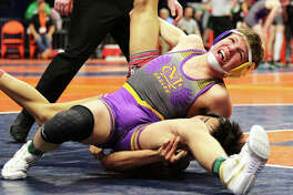 In last season's Class 2A state tournament, CM's Caine Tyus (top) wrestles Antioch's Danny McPherson during the fifth-place match at 126 pounds at State Farm Center in Champaign. McPherson won a 2-1 decision.