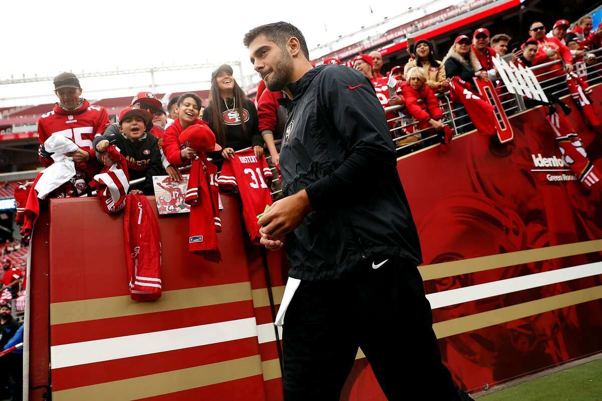 San Francisco 49ers' Jimmy Garoppolo heads out to warm up before playing Green Bay Packers during NFC Championship Game at Levi's Stadium in Santa Clara, Calif., on Sunday, January 19, 2020.