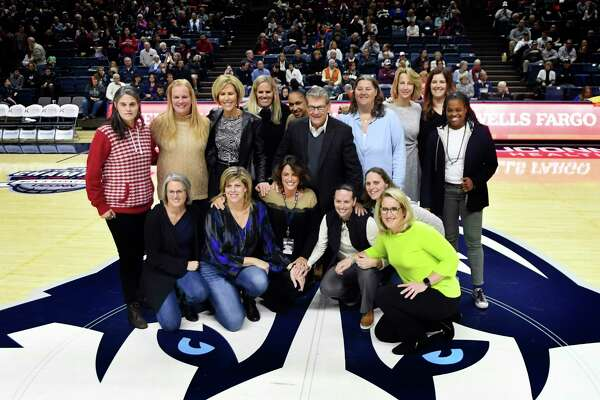 To celebrate the 30th anniversary of Gampel Pavilion, members of the 1989-90 Connecticut team, the first team to play there, came back to be honored at halftime during an NCAA college basketball game against Tulsa, Sunday, Jan. 19, 2020, in Storrs, Conn. (AP Photo/Stephen Dunn)