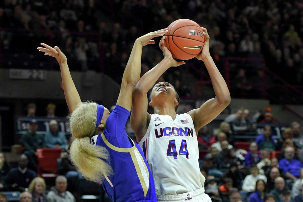 Connecticut's Aubrey Griffin (44) is fouled by Tulsa's Destiny Johnson (1) during the first half of an NCAA college basketball game Sunday, Jan. 19, 2020, in Storrs, Conn. (AP Photo/Stephen Dunn)