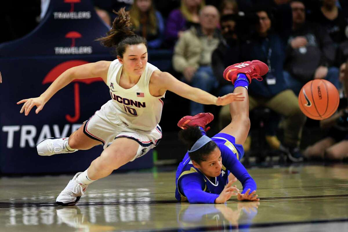 Connecticut's Molly Bent (10) goes for the ball against Tulsa's Rebecca Lescay (21) during the first half of an NCAA college basketball game Sunday, Jan.19, 2020, in Storrs, Conn. (AP Photo/Stephen Dunn)