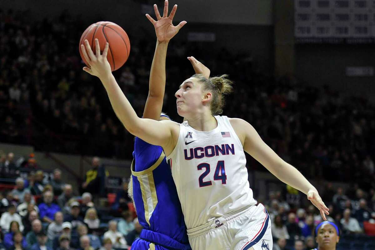 Connecticut's Anna Makurat (24) shoots during the first half of an NCAA college basketball game against Tulsa, Sunday, Jan. 19, 2020, in Storrs, Conn. (AP Photo/Stephen Dunn)