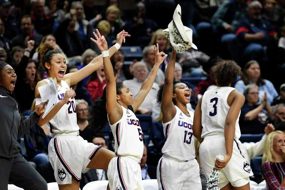 Connecticut's Olivia Nelson-Ododa (20), Crystal Dangerfield (5), Christyn Williams (13) and Megan Walker (3) cheer for a teammate during the second half of an NCAA college basketball game against Tulsa, Sunday, Jan. 19, 2020, in Storrs, Conn. (AP Photo/Stephen Dunn) Photo: Stephen Dunn / Associated Press / Copyright 2020 The Associated Press. All rights reserved