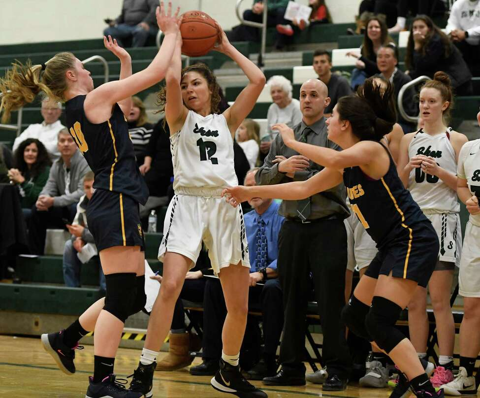 Shenendehowa's Rylee Carpenter looks for an out as Our Lady of Lourdes' Skyler Felice (10) and Mikayla Russo restrict her movement during a game at Shenendehowa High School in Clifton Park, N.Y., on Sunday, Jan. 19, 2020. (Jenn March, Special to the Times Union)