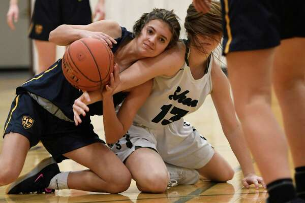 Our Lady of Lourdes' Amelia DeMelo looks to pass the ball after winning it from Shenendehowa's Bri Carey during a game at Shenendehowa High School in Clifton Park, N.Y., on Sunday, Jan. 19, 2020. (Jenn March, Special to the Times Union)