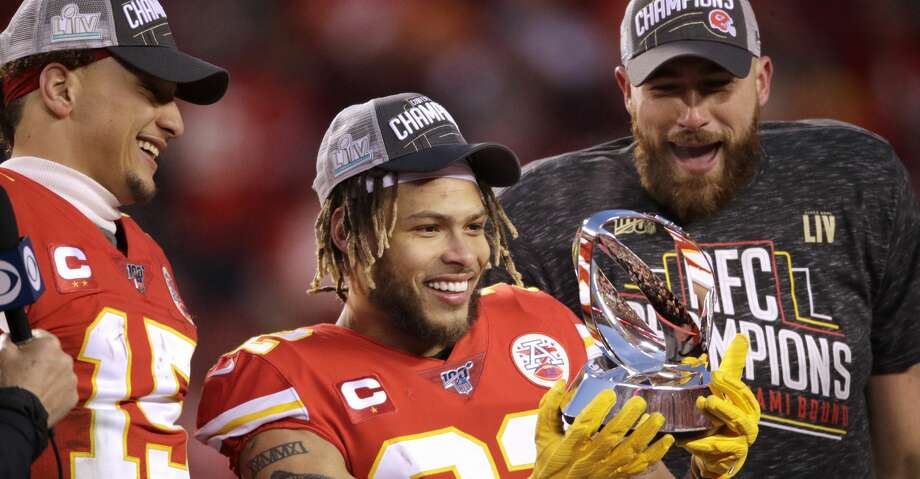 Kansas City Chiefs' Tyrann Mathieu is flanked by Patrick Mahomes, left, and Travis Kelce as he holds the Lamar Hunt Trophy after the NFL AFC Championship football game against the Tennessee Titans Sunday, Jan. 19, 2020, in Kansas City, MO. The Chiefs won 35-24 to advance to Super Bowl 54. (AP Photo/Charlie Riedel) Photo: Charlie Riedel/Associated Press