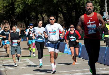 Runners make the final kick to the finish line of the Chevron Houston Marathon Sunday, Jan. 19, 2020 in Houston.