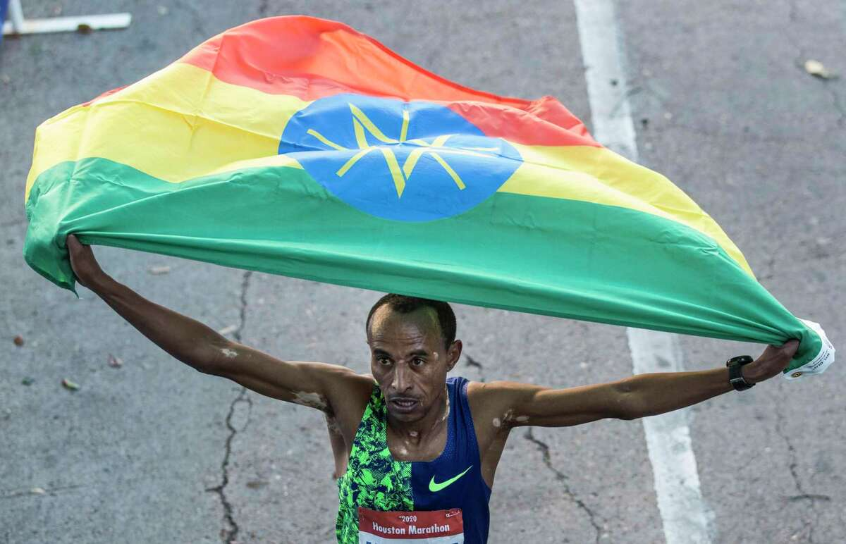 Ethiopia's Kelkile Gezahegn celebrates his win in the 48th running of the Houston Marathon.