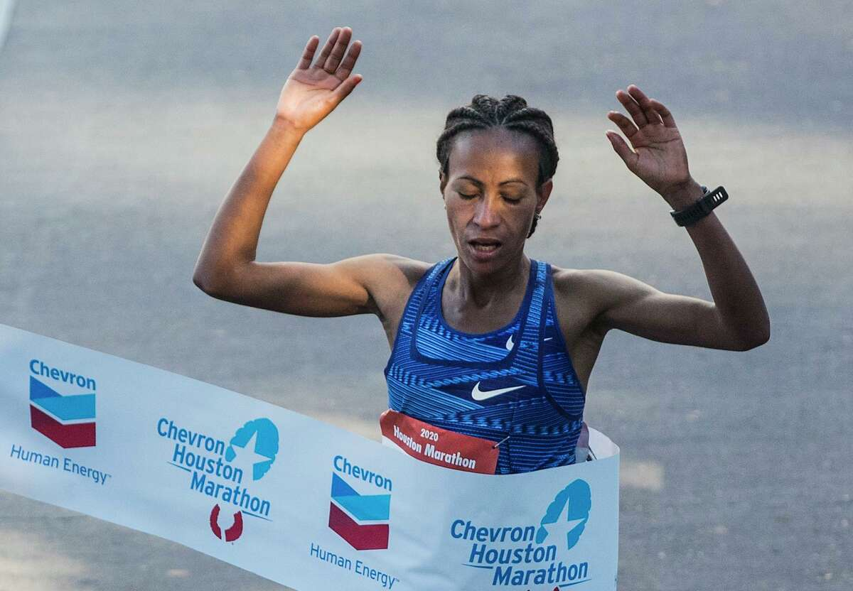 Ethiopia's Askale Merachi breaks the tape to win the women's race in the 48th running of the Houston Marathon.