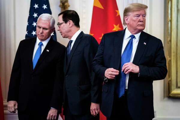 Vice President Mike Pence, left, Treasury Secretary Steven Mnuchin and President Trump confer before signing a trade agreement with China on Jan. 15.