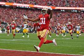 Raheem Mostert scores a touchdown against the Green Bay Packers in the 2019 NFC Championship.