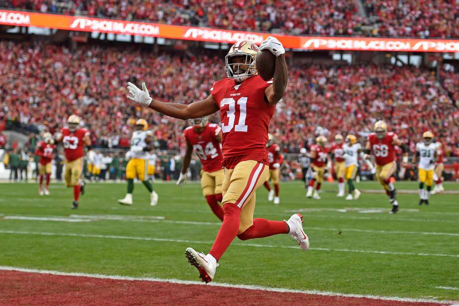 Raheem Mostert scores a touchdown against the Green Bay Packers in the 2019 NFC Championship. Photo: Getty Images / Bay Area News Group