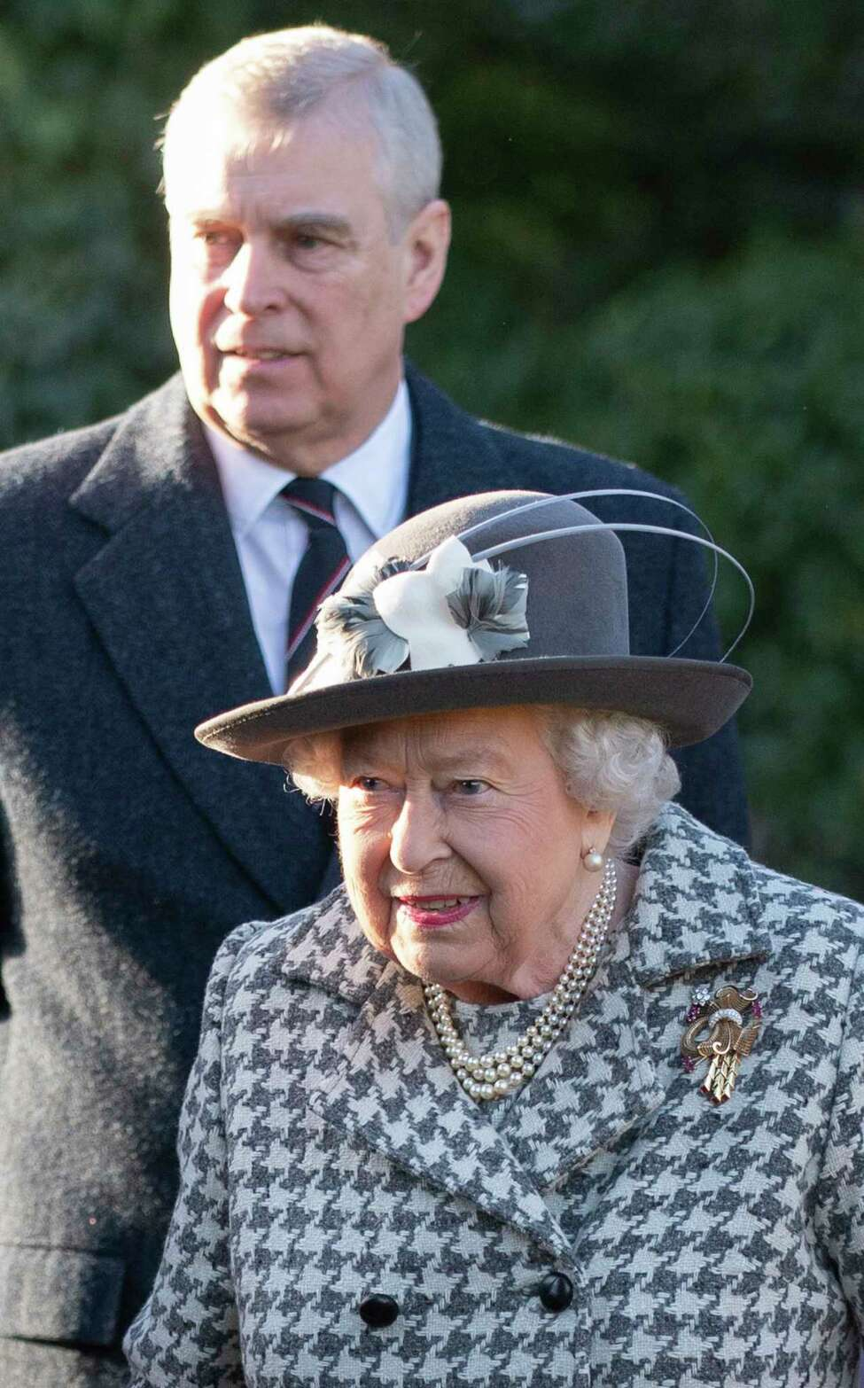 Britain's Queen Elizabeth II and Prince Andrew arrive at St Mary the Virgin, in Hillington, England, to attend a Sunday church service, Sunday, Jan. 19, 2020. Buckingham Palace says Prince Harry and his wife, Meghan, will no longer use the titles