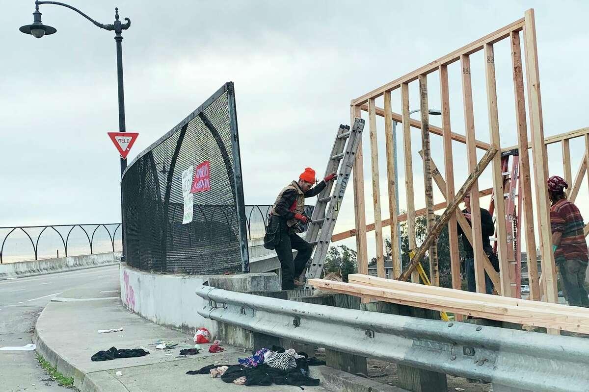 Volunteers construct housing in Oakland.