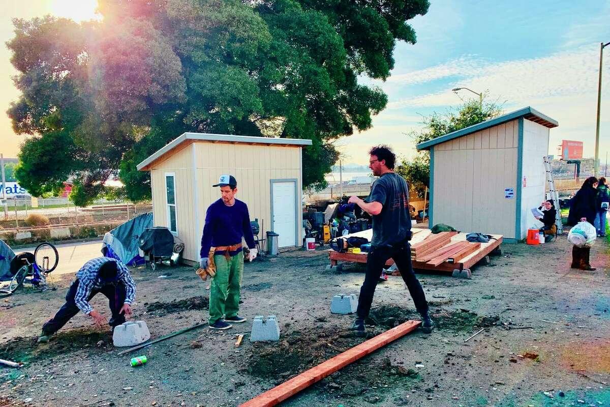 Volunteers build tiny homes.