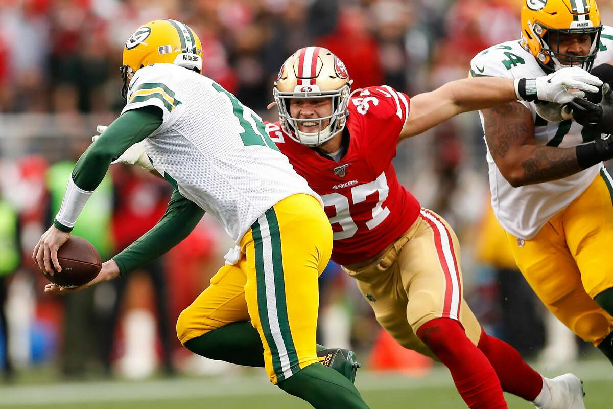San Francisco 49ers' Nick Bosa chases Green Bay Packers' Aaron Rodgers in the first quarter during the NFC Championship game between the San Francisco 49ers and the Green Bay Packers at Levi's Stadium on Sunday, Jan. 19, 2020 in Santa Clara, Calif.