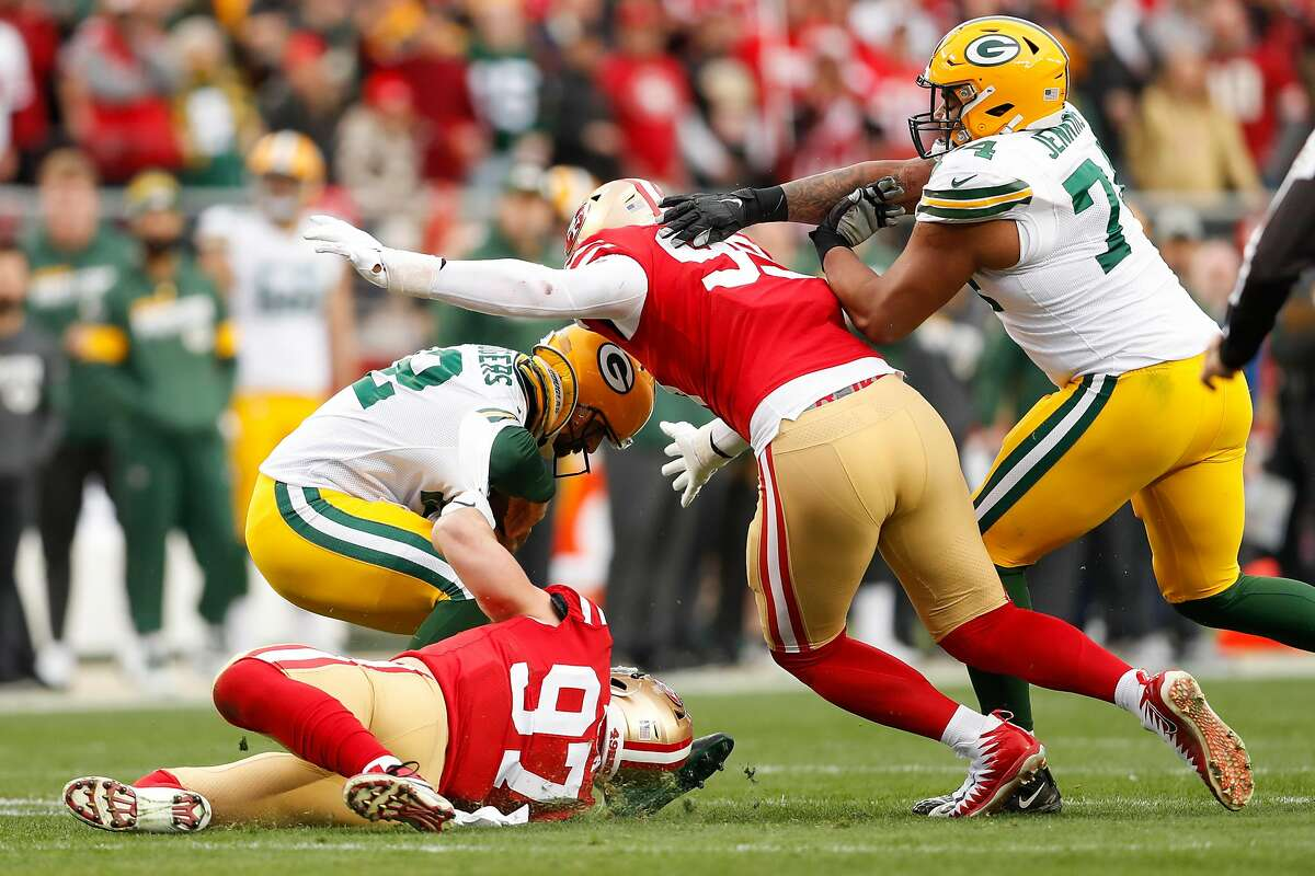 San Francisco 49ers' Nick Bosa gets a hold on Green Bay Packers' Aaron Rodgers for a sack in the first quarter during the NFC Championship game between the San Francisco 49ers and the Green Bay Packers at Levi's Stadium on Sunday, Jan. 19, 2020 in Santa Clara, Calif.